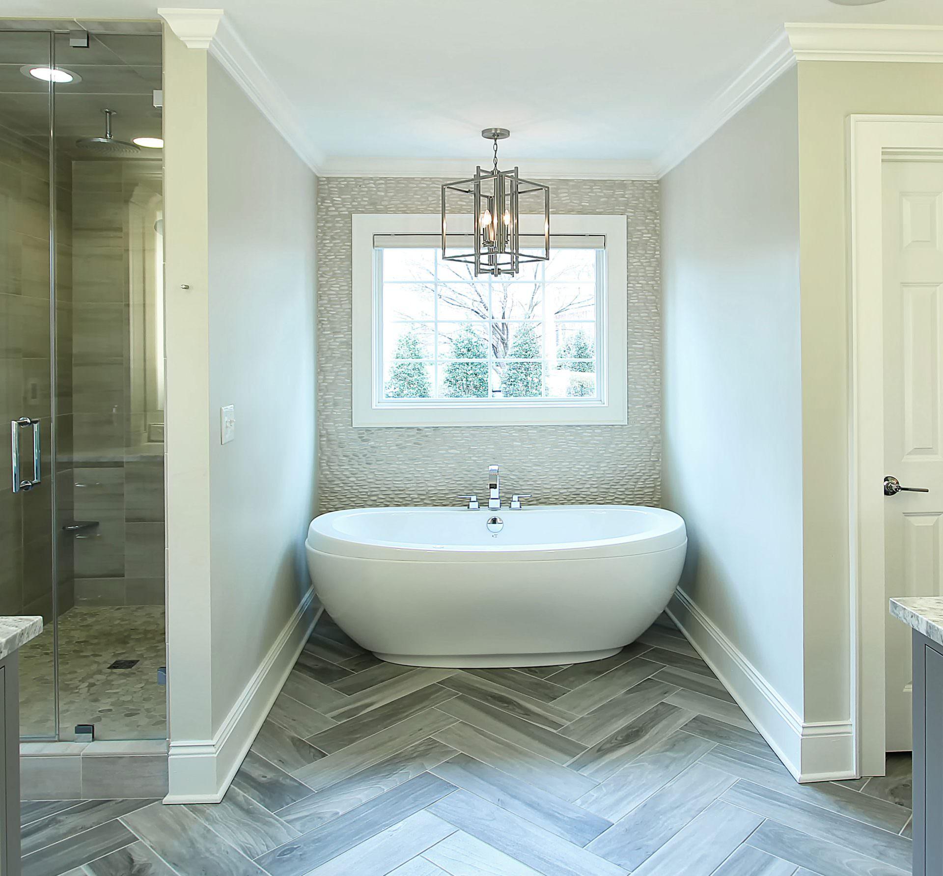 Master-Bath-Herringbone-floor-tile-pebble-backsplash-Large