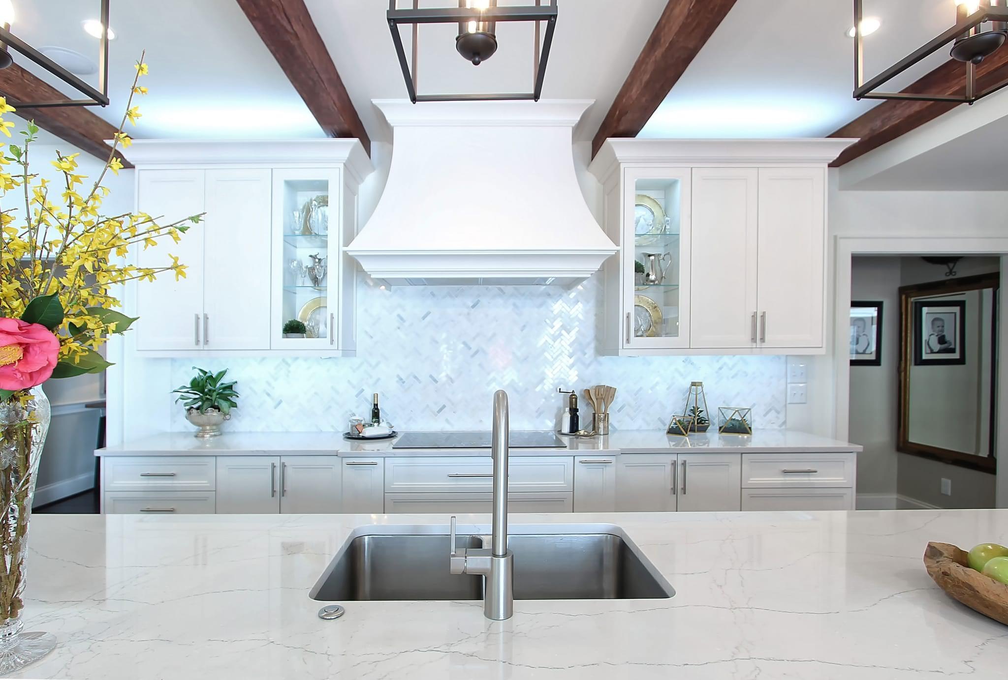 White Custom Kitchen Open Concept Storage Marble Herringbone Backsplash Greenbrook Design Center