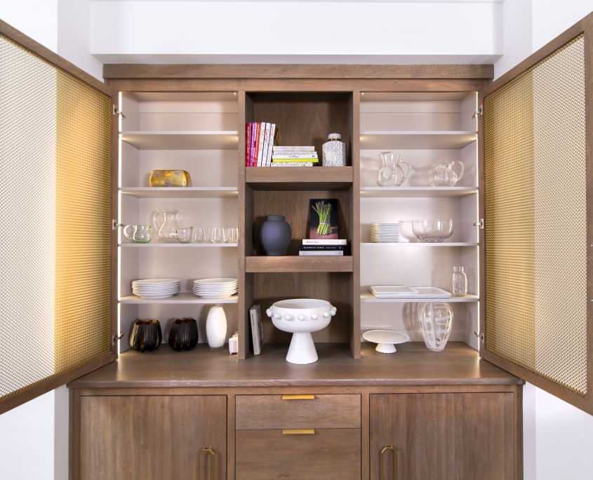 white oak kitchen hutch with open doors and brass hardware