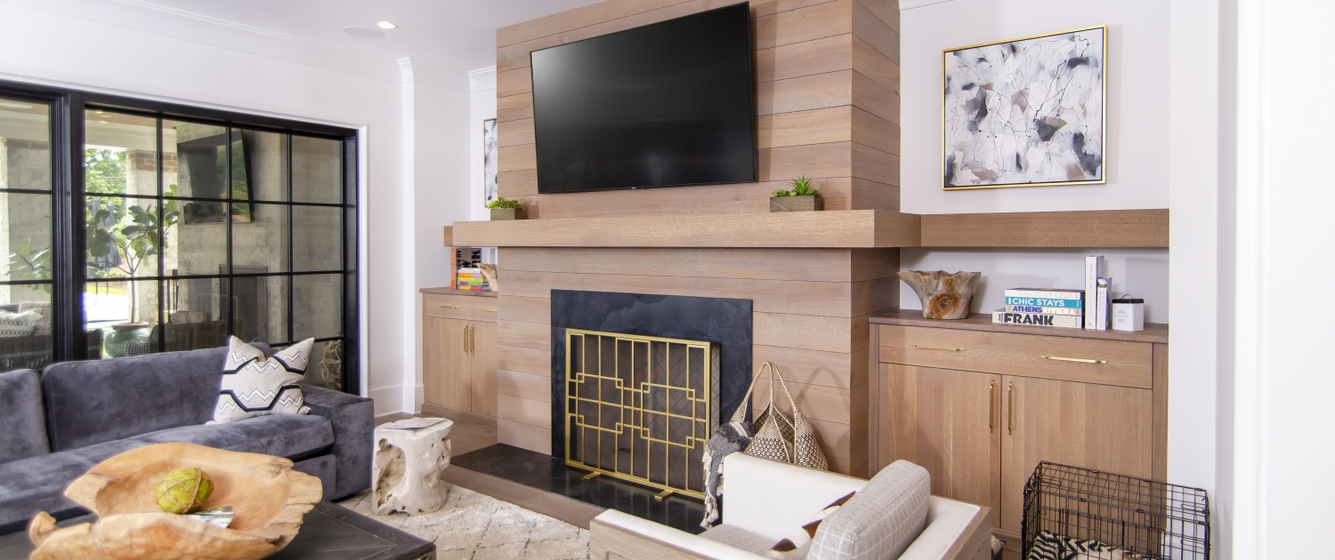 white oak fireplace mantle and accent wall in living room