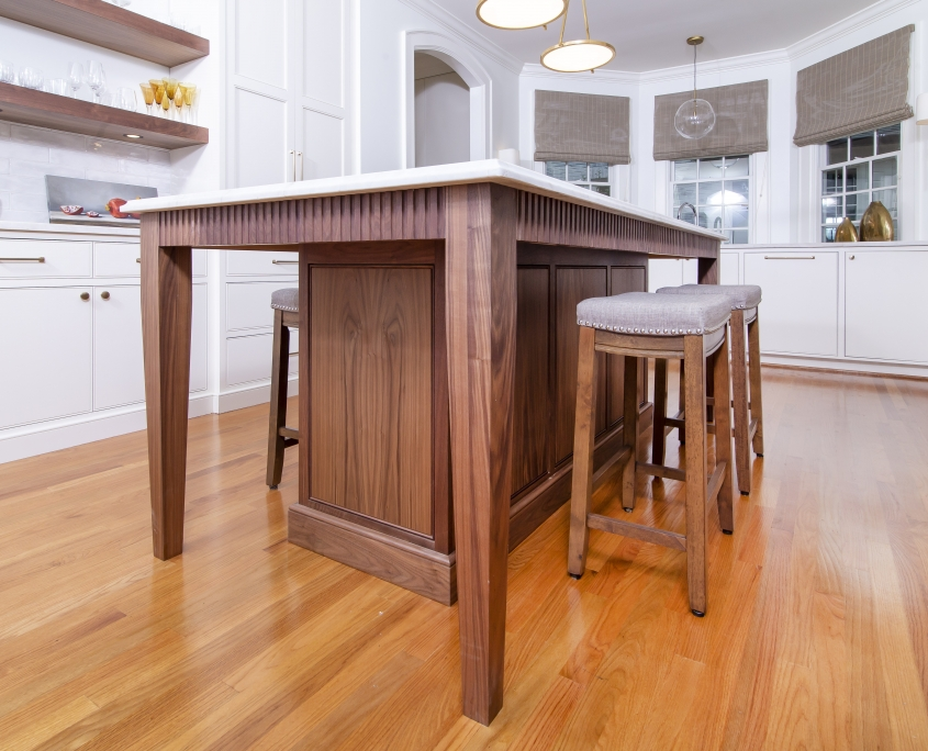 Walnut wood kitchen island with barstools in white kitchen