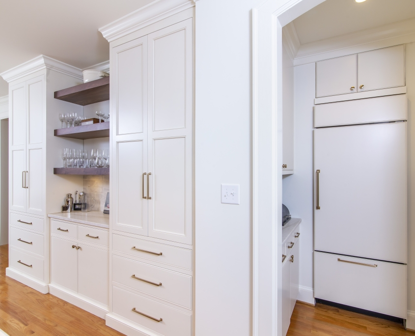 White kitchen cabinets with brass hardware